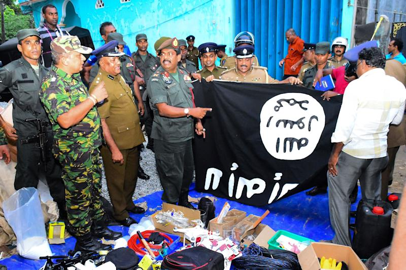 In this picture taken on April 26, 2019, security personnel inspect seized items after they raid what was believed to be an Islamist safe house in the eastern town of Kalmunai. (Photo: AFP/Getty Images)