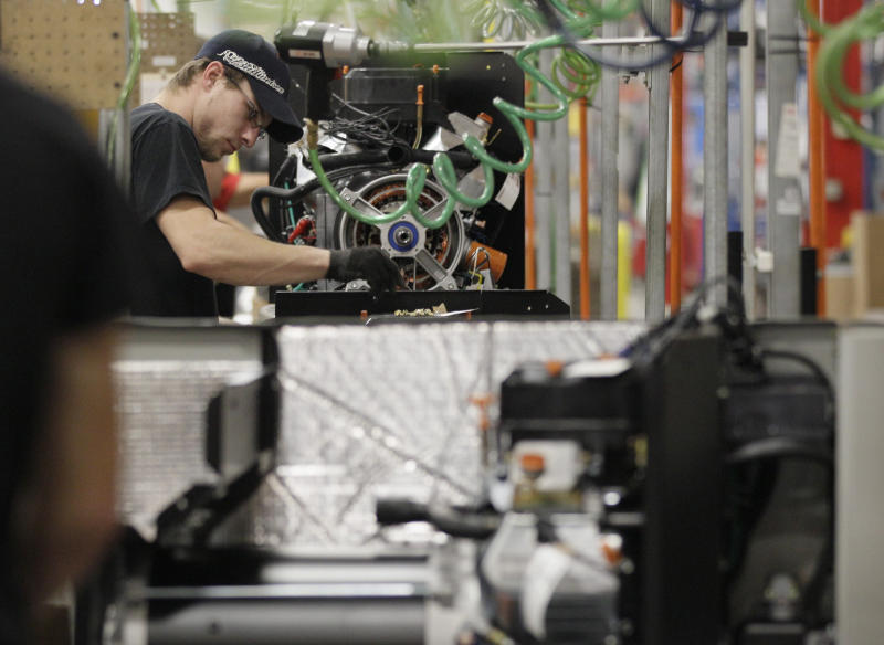 US manufacturing expanded slightly last month