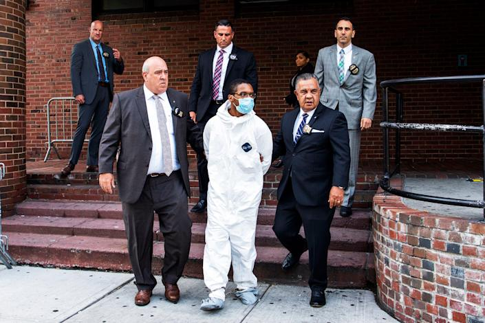 Tyrese Haspil, 21, is escorted out of the 7th precinct by NYPD detectives, Friday, July 17, 2020, in New York. Haspil faces a murder charge in the death of Fahim Saleh, 33-year-old tech entrepreneur who was found dismembered inside his luxury Manhattan condo.