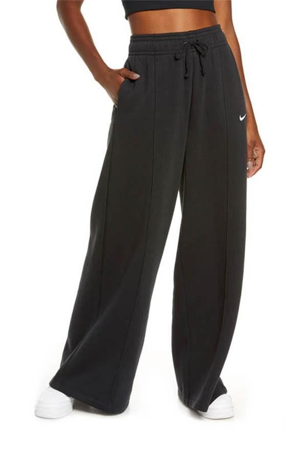 "These flared palazzo pants feel like pajamas but look like sweats, and are perfect for your roommate whose WFH wardrobe could use a refresh. $60, Nordstrom. <a href=""https://www.nordstrom.com/s/nike-sportswear-knit-palazzo-pants/5521379"" rel=""nofollow noopener"" target=""_blank"" data-ylk=""slk:Get it now!"" class=""link rapid-noclick-resp"">Get it now!</a>"
