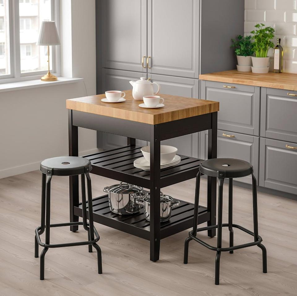 "<p>The freestanding <a href=""https://www.popsugar.com/buy/Vadholma%20Kitchen%20Island-447007?p_name=Vadholma%20Kitchen%20Island&retailer=ikea.com&price=299&evar1=casa%3Aus&evar9=46151613&evar98=https%3A%2F%2Fwww.popsugar.com%2Fhome%2Fphoto-gallery%2F46151613%2Fimage%2F46152196%2FVadholma-Kitchen-Island&list1=shopping%2Cikea%2Corganization%2Ckitchens%2Chome%20shopping&prop13=api&pdata=1"" rel=""nofollow noopener"" target=""_blank"" data-ylk=""slk:Vadholma Kitchen Island"" class=""link rapid-noclick-resp"">Vadholma Kitchen Island</a> ($299) is small and compact, while also giving you room to store things on the lower shelves. It is also easy to move, so you can have the freedom to place it in the best spot of the kitchen.</p>"