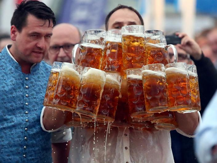 German Oliver Struempfel competes to set a new world record in carrying one liter beer mugs over a distance of 40 m (131 ft 3 in) in Abensberg, Germany September 3, 2017. Struempfel carried 29 mugs over 40 meters to set a new world record. REUTERS/Michael Dalder     TPX IMAGES OF THE DAY