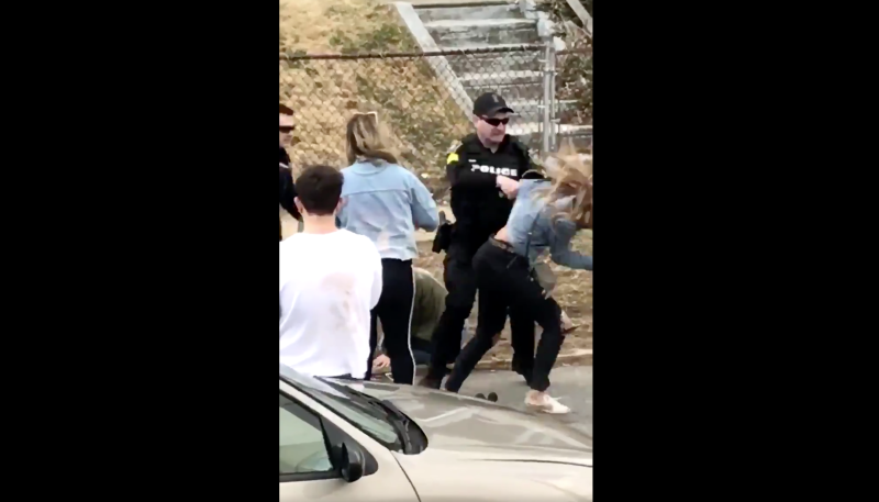 18e3b705c Police punch woman in viral St. Patrick's Day video