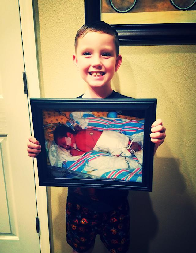 This is Landon, and he's holding a picture of himself from the day he was born. He was born more than eight weeks premature and spent the first 31 days of his life in the NICU. My younger brother was born six weeks early and my uncle was born eight weeks early back in the 1950s and he did not survive. Every generation in our family has had a preemie. Landon is our little miracle and we can't thank the wonderful NICU nurses and doctors enough for saving his life! He is now 8 years old and perfectly healthy.<br><br><i>--Melissa and Aric Straub</i>