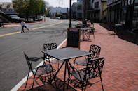 WESTPORT, CONNECTICUT - MAY 05: A cafe along a shopping street in the affluent community remains mostly empty of pedestrians and open stores on May 05, 2020 in Westport, Connecticut. A growing number of states have begun reopening parts of the economy amid demonstrations like the one yesterday that targeted the Connecticut state capital and the governor's mansion in Hartford. (Photo by Spencer Platt/Getty Images)