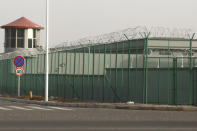 "FILE - In this Monday, Dec. 3, 2018, file photo, a guard tower and barbed wire fences surround an internment facility in the Kunshan Industrial Park in Artux in western China's Xinjiang Uyghur Autonomous Region. A spokesperson for the Xinjiang region called accusations of genocide ""totally groundless"" as the British parliament approved a motion Thursday, April 22, 2021 that said China's policies amounted to genocide and crimes against humanity. (AP Photo/Ng Han Guan, File)"