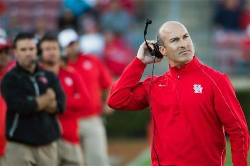 Houston head coach Tony Levine, right, looks to the scoreboard during the first half of an NCAA college football game against Tulane, Saturday, Nov. 24, 2012, in Houston. (AP Photo/Houston Chronicle, Smiley N. Pool)
