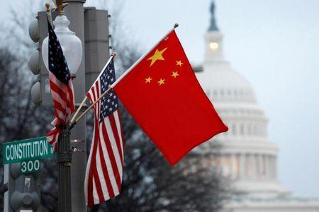 China flag and the U.S. Stars and Stripes fly on a lamp post Pennsylvania in Washington