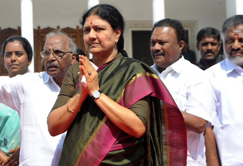"""VK Sasikala (centre), general secretary of Tamil Nadu state's ruling AIADMK, was ordered to surrender to prison authorities after judges quashed her acquittal in a $10 million """"disproportionate assets"""" case"""