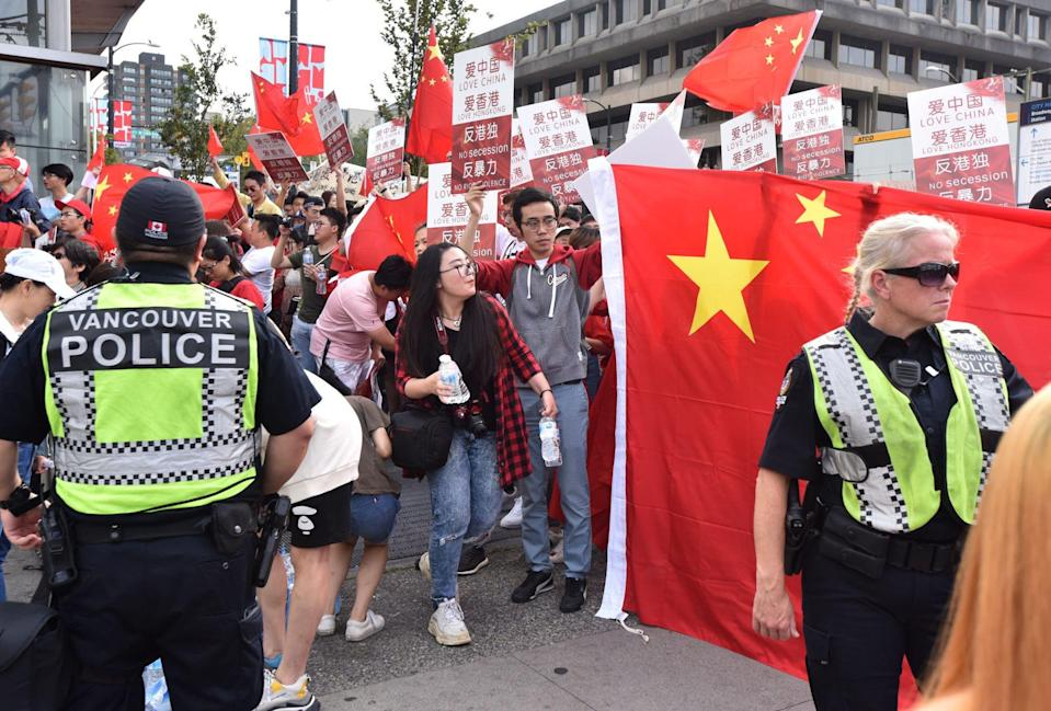 Vancouver police separate supporters and opponents of the Hong Kong protest movement at duelling rallies on August 17, 2019. Photo: AFP