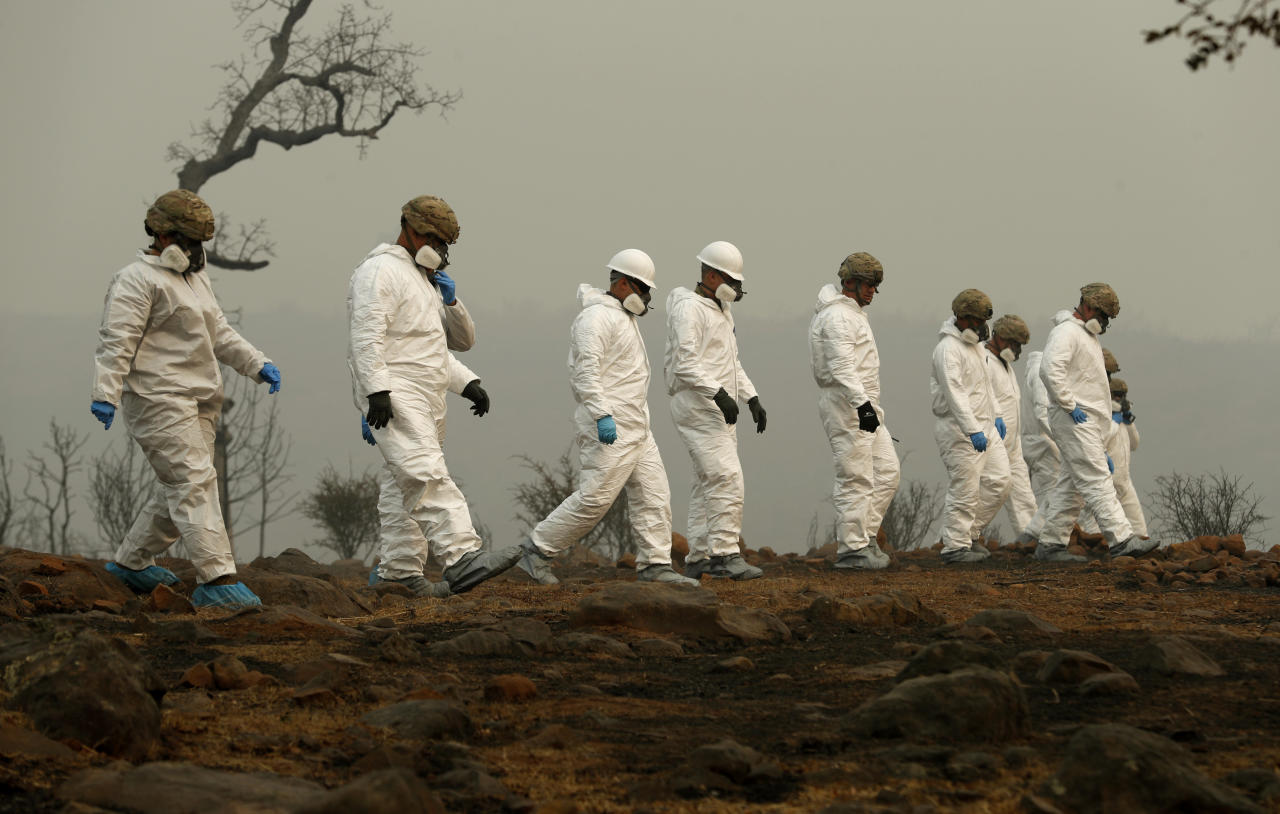 <p>Members of the California Army National Guard search a property for human remains at the Camp fire, Wednesday, Nov. 14, 2018, in Paradise, Calif. (Photo: John Locher/AP) </p>