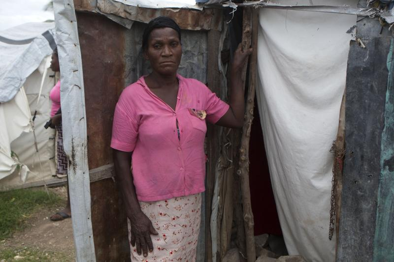 Paul Licile, 53, poses for a portrait at her tent in a camp set up for people displaced by the 2010 earthquake, where she will wait out Tropical Storm Isaac in Port-au-Prince, Haiti, Friday, Aug. 24, 2012. Tropical Storm Isaac strengthened slightly as it spun toward the Dominican Republic and vulnerable Haiti on Friday, threatening to bring punishing rains but unlikely to gain enough steam to strike as a hurricane. (AP Photo/Dieu Nalio Chery)