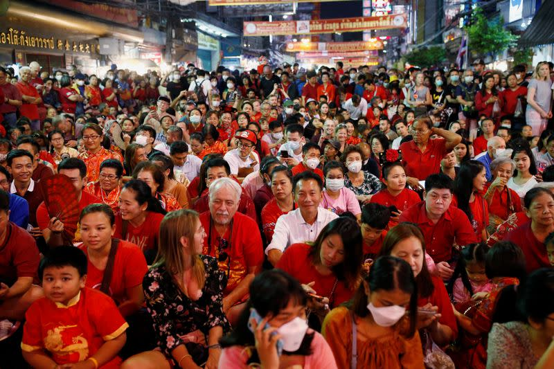 People wear masks as they celebrate Chinese Lunar New Year in Chinatown in Bangkok