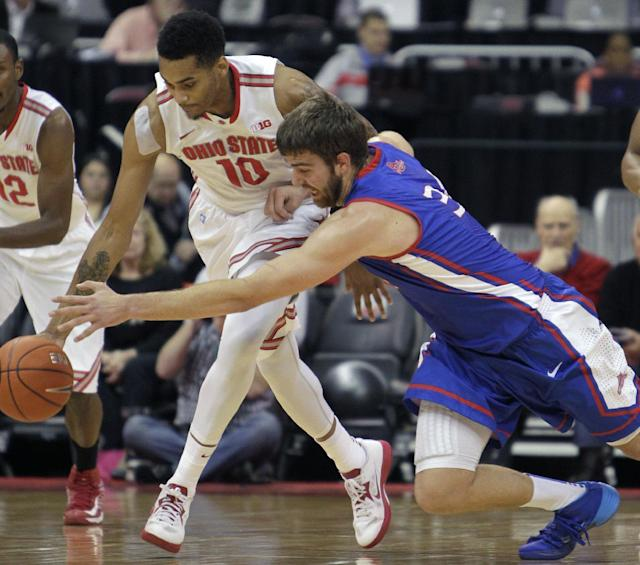 American's Tony Wroblicky, right, and Ohio State's LaQuinton Ross chase a loose ball during the first half of an NCAA college basketball game Wednesday, Nov. 20, 2013, in Columbus, Ohio. (AP Photo/Jay LaPrete)