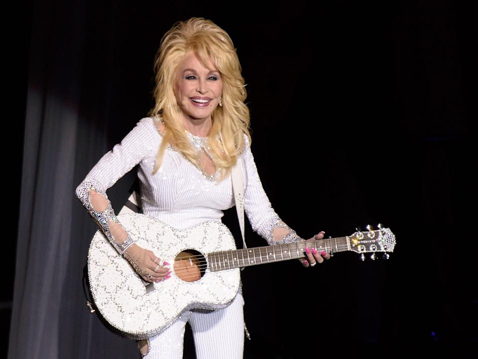 Dolly Parton performs during the Pure & Simple tour in 2016.