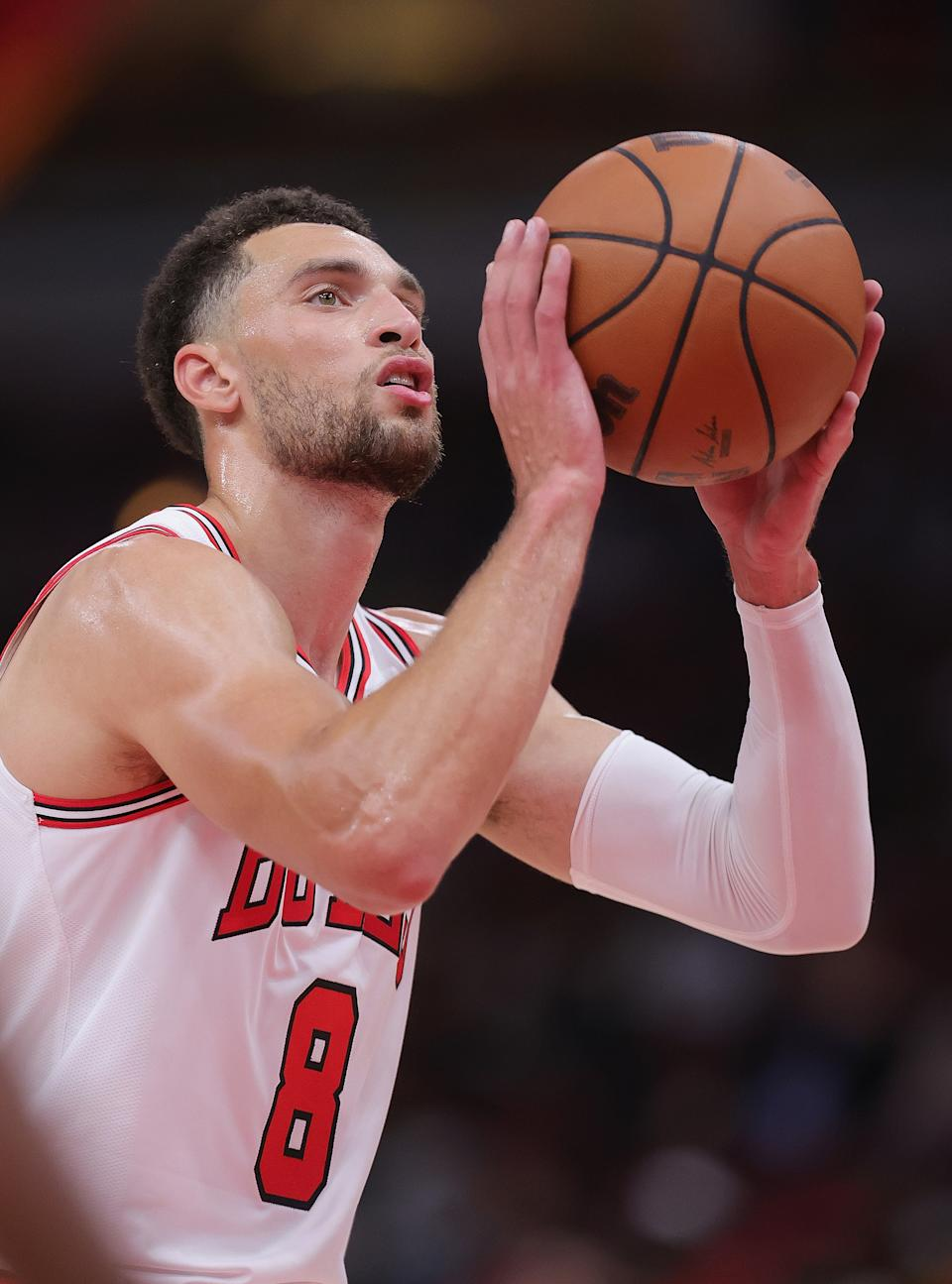 CHICAGO, ILLINOIS - OCTOBER 05: Zach LaVine #8 of the Chicago Bulls shoots a free throw against the Cleveland Cavaliers during a preseason game at the United Center on October 05, 2021 in Chicago, Illinois. The Bulls defeated the Cavaliers 131-95. NOTE TO USER: User expressly acknowledges and agrees that, by downloading and or using this photograph, User is consenting to the terms and conditions of the Getty Images License Agreement. (Photo by Jonathan Daniel/Getty Images)