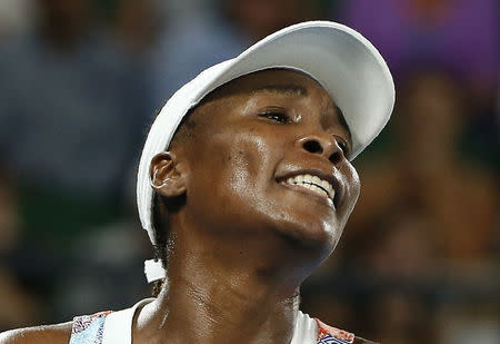 Tennis - Australian Open - Venus Williams of the U.S. v Belinda Bencic of Switzerland - Rod Laver Arena, Melbourne, Australia, January 15, 2018. Williams reacts after losing a point. REUTERS/Thomas Peter