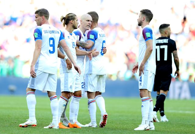 <p>The Iceland players know it's a job well done after securing their first ever World Cup point </p>