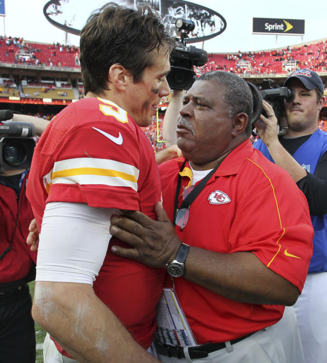 Kansas City Chiefs coach Romeo Crennel, right, talks with quarterback Brady Quinn (9) following an NFL football game against the Carolina Panthers at Arrowhead Stadium in Kansas City, Mo., Sunday, Dec. 2, 2012. The Chiefs defeated the Panthers 27-21. The win came one day after Chiefs' Jovan Belcher fatally shot his girlfriend and later turned a gun on himself as GM Scott Pioli and Crennel looked on. (AP Photo/Colin E. Braley)