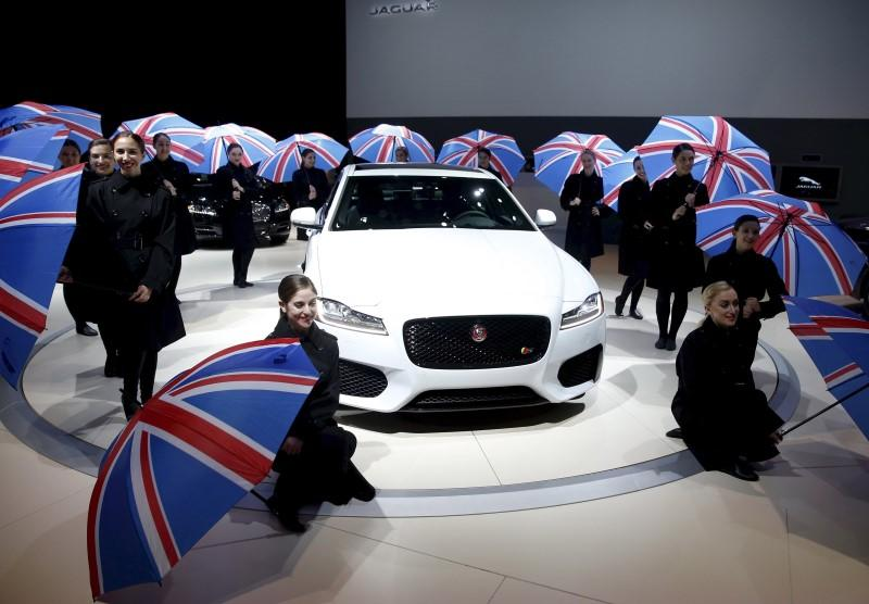 Union flag umbrellas are seen as the 2016 Jaguar XF is introduced at the New York International Auto Show in New York City in this April 1, 2015 file photo. REUTERS/Shannon Stapleton/Files