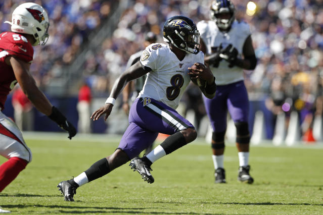 Lamar Jackson's passing is pretty for a running back. As it turns out, so is his running. (Photo by Todd Olszewski/Getty Images)
