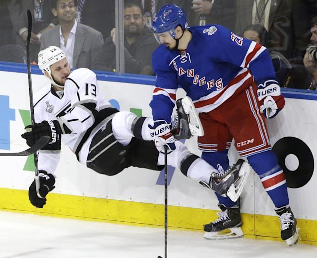Los Angeles Kings left wing Kyle Clifford (13) looses his footing against New York Rangers left wing Chris Kreider (20) in the second period during Game 4 of the NHL hockey Stanley Cup Final, Wednesday, June 11, 2014, in New York. (AP Photo/Frank Franklin II)