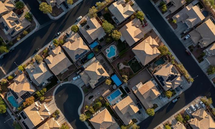 Houses, trees and swimming pools spring from the desert in Henderson, Nevada.