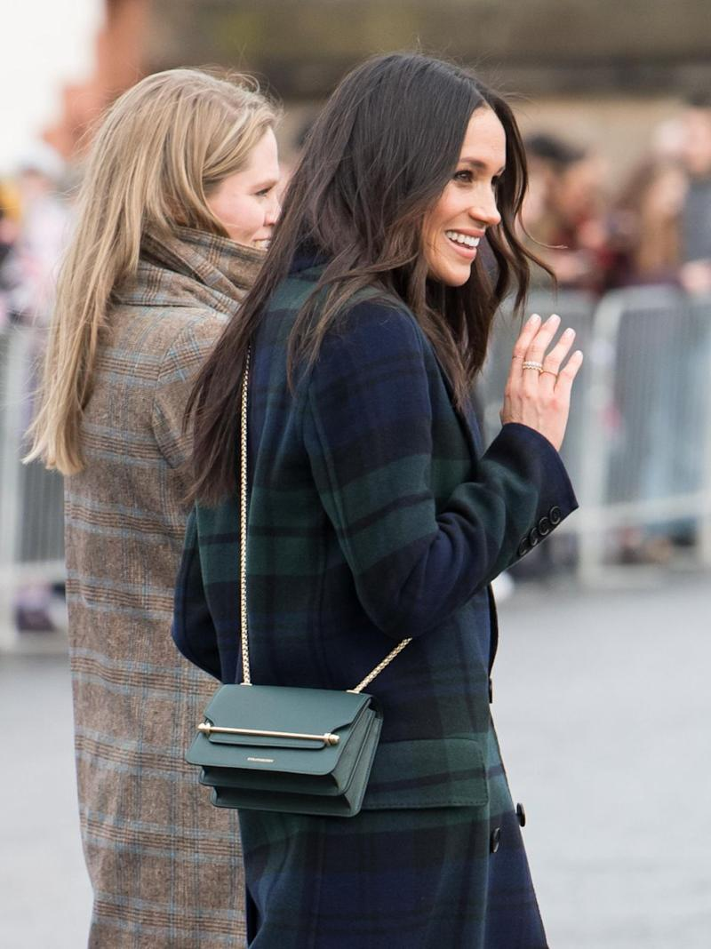 The bride-to-be wore a bottle green cross body bag. Photo: Getty Images