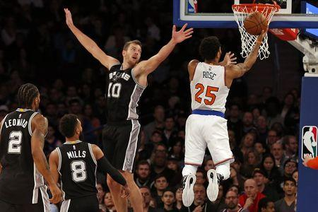 Feb 12, 2017; New York, NY, USA; New York Knicks guard Derrick Rose (25) drives to the basket past San Antonio Spurs forward David Lee (10) during the second half at Madison Square Garden. Mandatory Credit: Adam Hunger-USA TODAY Sports