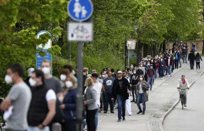 People queue at a vaccination centre in Ebersberg near Munich, Germany, Saturday, May 15, 2021. Hundreds of people have lined up at an improvised vaccination center near Munich to get one of 1,000 doses of the AstraZeneca coronavirus vaccine that were on offer. Police said that around 850 people were standing in line at around 10 a.m. -- and some of them had arrived as early as 5 a.m. (AP Photo/Matthias Schrader)