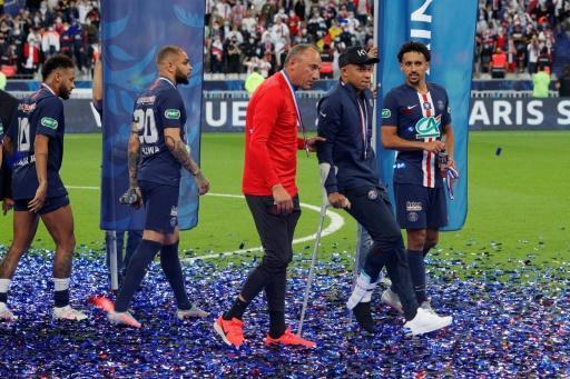 Kylian Mbappe on crutches after the trophy ceremony