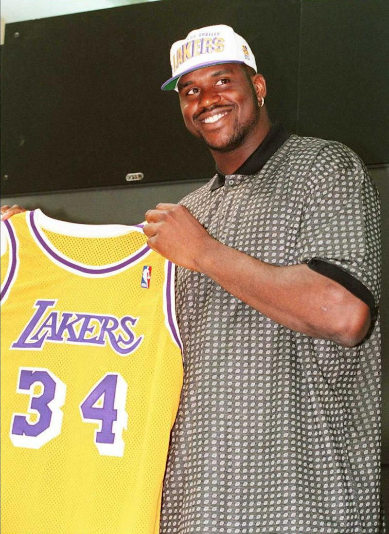 "ATLANTA, GA - JULY 18: US Olympic ""Dream Team III"" basketball player Shaquille O'Neal holds his Los Angeles Lakers uniform jersey 18 July during a press conference by the team in Atlanta. O'Neal signed a seven-year, 123-million USD contract with the Lakers making it the richest deal in sports history. (Photo credit should read MICHEL GAGNE/AFP/Getty Images)"