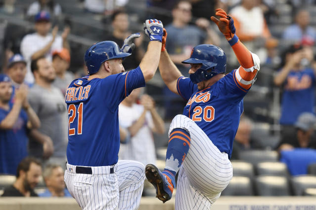 New York Mets' Pete Alonso (20) celebrates with Todd Frazier (21) after hitting a home run during the first inning of a baseball game against the Washington Nationals, Monday, May 20, 2019, in New York. (AP Photo/Sarah Stier)