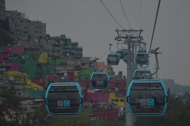 The cable car can carry up to 5,000 people an hour between six stations, according to the mayor's office