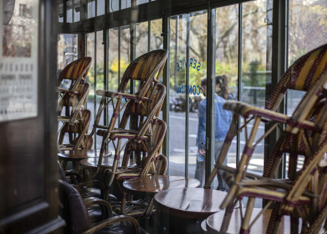 Chairs stacked against the windows of a closed cafe on Sunday in Paris. (Reuters)