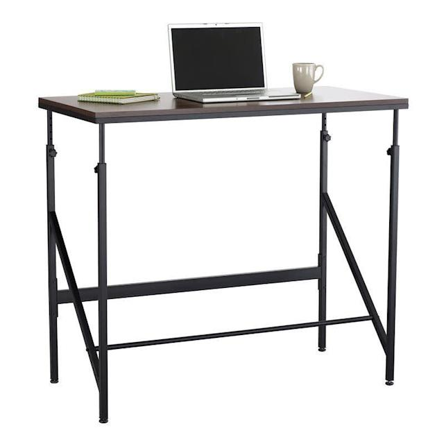 This adjustable height standing desk also features an adjustable footrest. <span>Shop it here</span>.