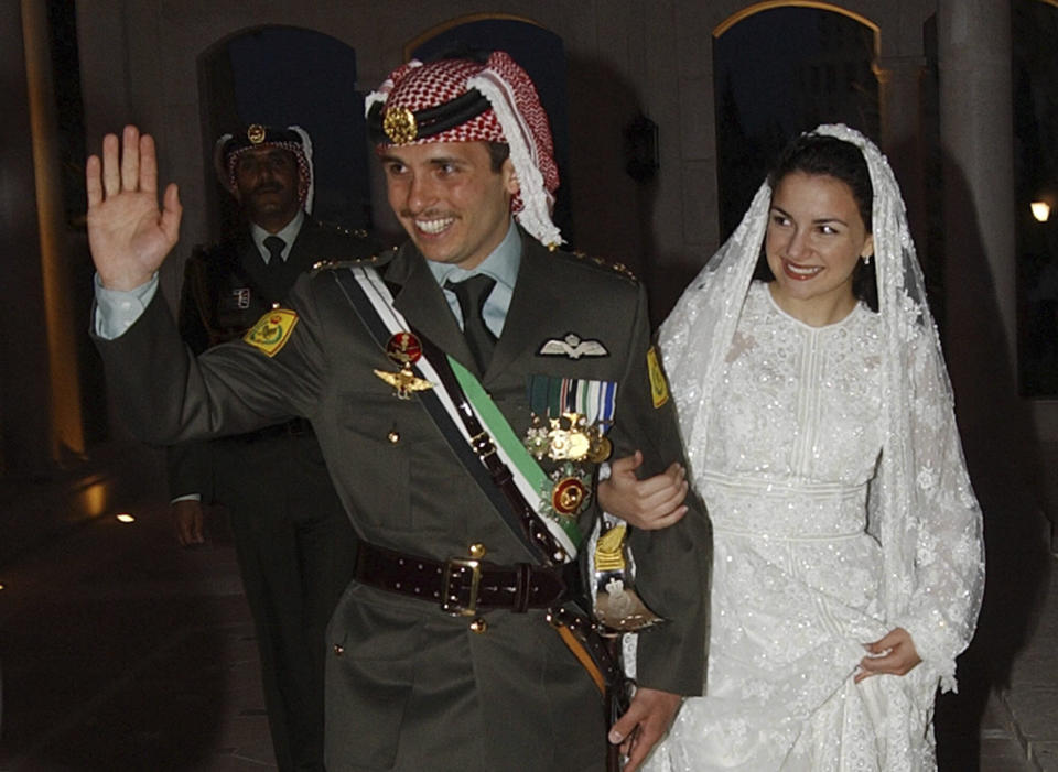 File - In this May 27, 2004, file photo, Jordan's Prince Hamzeh and his wife Princess Noor, arrive at Zahran Palace where they celebrate their wedding ceremony in Amman, Jordan. Prince Hamza, the half-brother of Jordan's King Abdullah II, said he has been placed under house arrest. in a videotaped statement late Saturday, April 3, 2021. (AP Photo/Hussein Malla, File)
