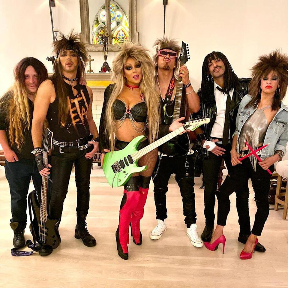 According to the singer's Instagram, this group of headbangers is called Spit featuring Mimi. We love all that hair.