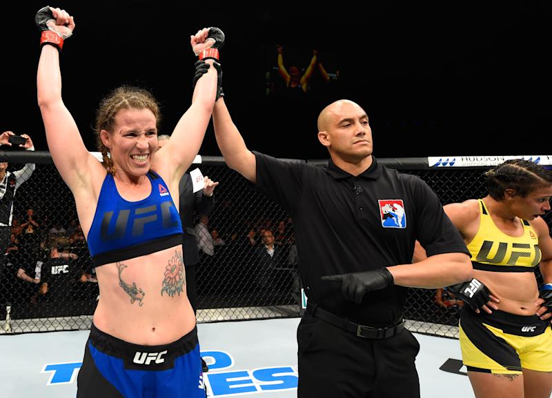 GLASGOW, SCOTLAND - JULY 16: (L-R) Leslie Smith celebrates her victory over Amanda Lemos of Brazil in their women's bantamweight bout during the UFC Fight Night event at the SSE Hydro Arena Glasgow on July 16, 2017 in Glasgow, Scotland. (Photo by Josh Hedges/Zuffa LLC/Zuffa LLC via Getty Images)