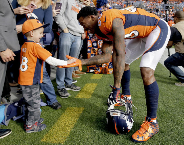<p>Denver Broncos wide receiver Demaryius Thomas (88) greets a young fan prior to an NFL football game against the Cincinnati Bengals, Sunday, Nov. 19, 2017, in Denver. (AP Photo/Jack Dempsey) </p>