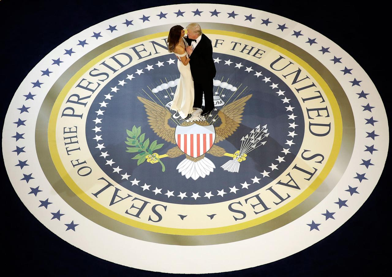 <p>President Donald Trump dances with first lady Melania Trump, at The Salute To Our Armed Services Inaugural Ball in Washington, Friday, Jan. 20, 2017. (Evan Vucci/AP) </p>