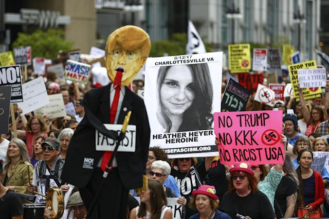 A Chicago demonstrator holds a banner in memory of Heather Heyer, who was killed Aug. 12 by a driver in Charlottesville, Virginia, during a protest against racism and hate on Aug. 27.