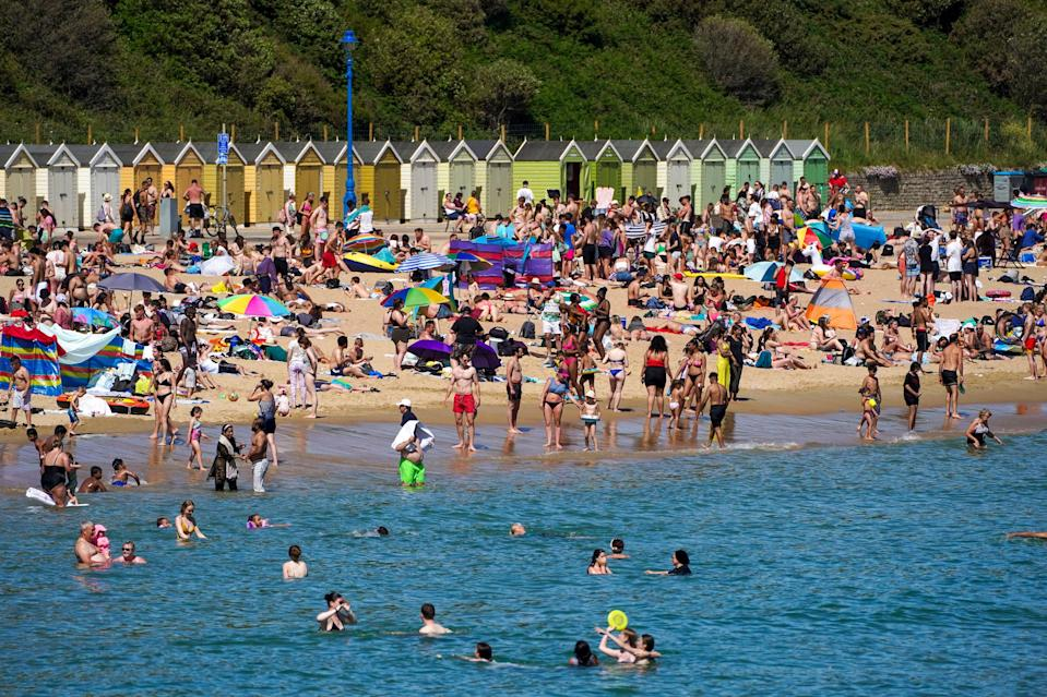 People flocked to beaches including in Bournemouth (PA)