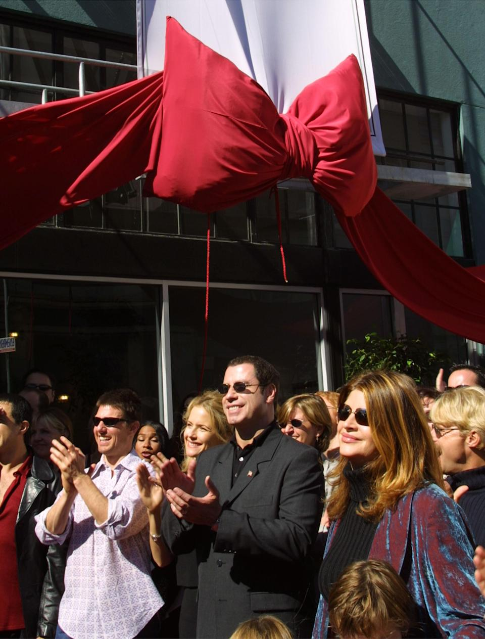 Actors Tom Cruise, Kelly Preston, John Travolta, and Kirstie Alley listen to Jenna Elfman speak at the opening of the Church of Scientology, Mission of SoMa (San Francisco), in September 2001. (Photo: Getty Images).