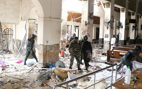 Security forces inspect the St. Anthony's Shrine after an explosion hit St Anthony's Church in Kochchikade in Colombo, Sri Lanka - Credit: Chamila Karunarathne/Anadolu Agency/Getty Images