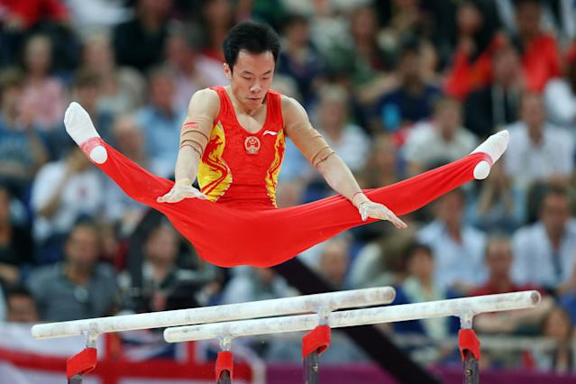 LONDON, ENGLAND - JULY 30: Weiyang Gao of China competes on the parallel bars in the Artistic Gymnastics Men's Team final on Day 3 of the London 2012 Olympic Games at North Greenwich Arena on July 30, 2012 in London, England. (Photo by Streeter Lecka/Getty Images)