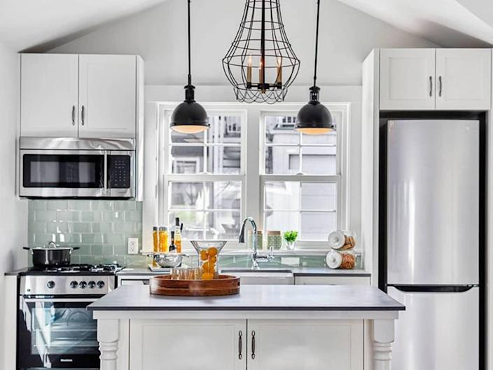A large central kitchen island like this one makes cooking easier and a whole lot more enjoyable.