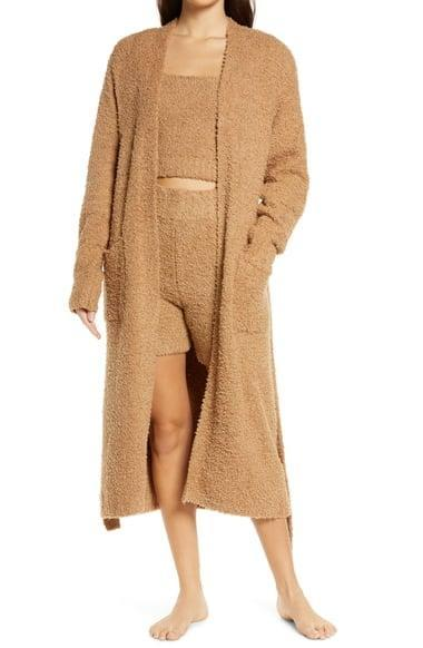 <p>This chic <span>Skims Cozy Knit Bouclé Robe</span> ($128) comes in several colors.</p>