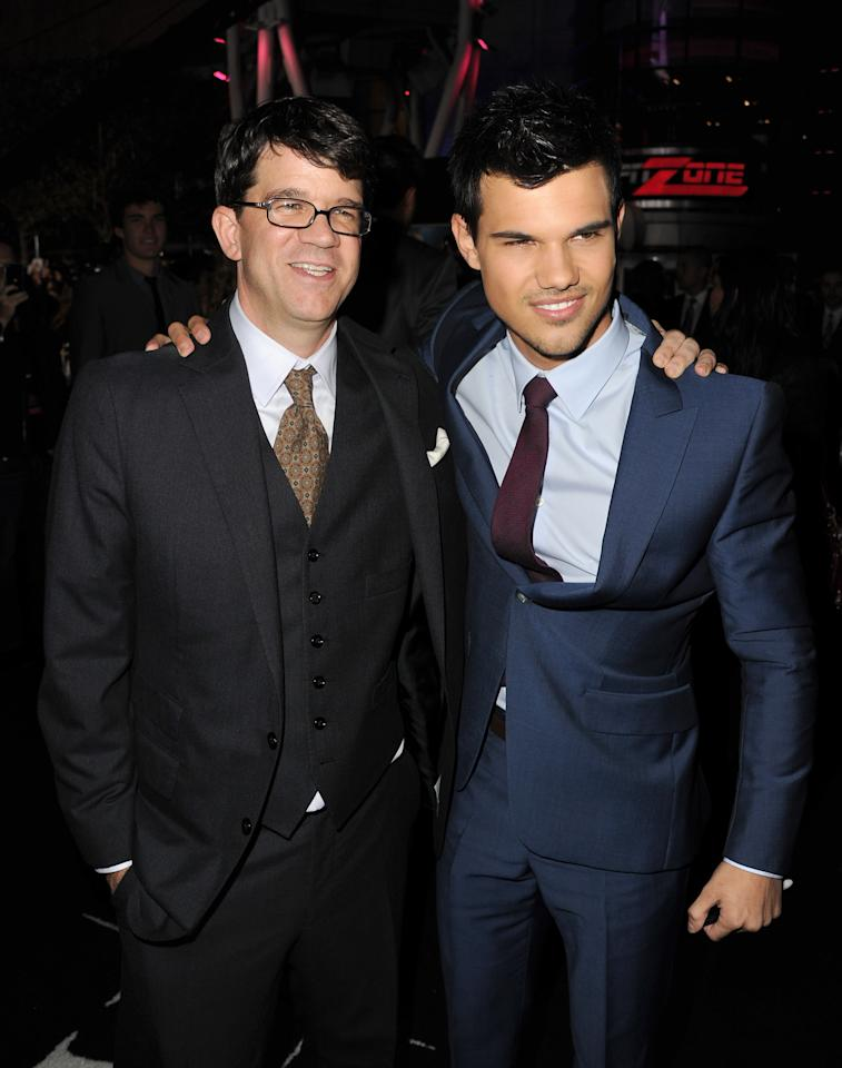 "LOS ANGELES, CA - NOVEMBER 14:  Producer Wyck Godfrey (L) and actor Taylor Lautner arrive at the premiere of Summit Entertainment's ""The Twilight Saga: Breaking Dawn - Part 1"" at Nokia Theatre L.A. Live on November 14, 2011 in Los Angeles, California.  (Photo by Kevin Winter/Getty Images)"