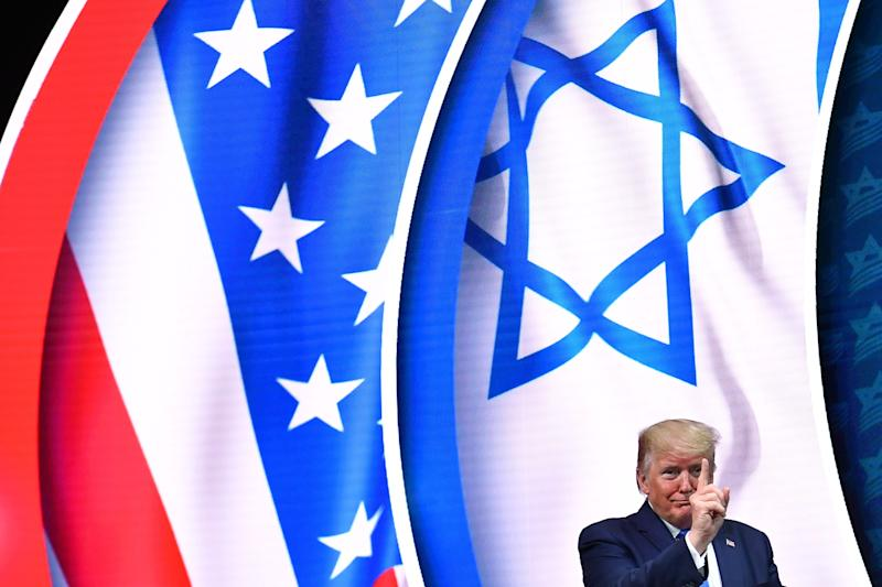 US President Donald Trump stands on stage after his address to the Israeli American Council National Summit 2019 at the Diplomat Beach Resort in Hollywood, Florida on December 7, 2019.